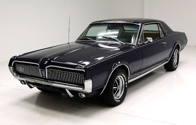 a black 1967 Mercury Cougar