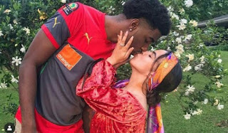 See How Low This Tall Man Has To Go To Kiss His Petite Wife [Photos]