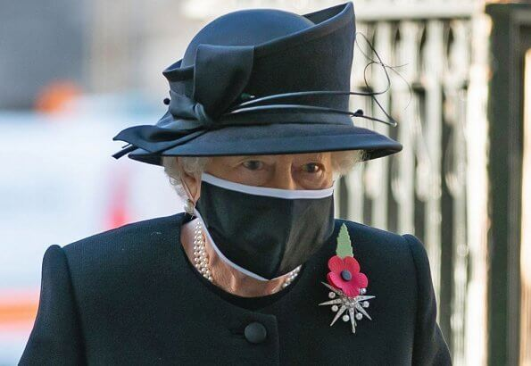 Queen Elizabeth wore a black mask and Jardine diamond star brooch.  National Service of Remembrance at The Cenotaph
