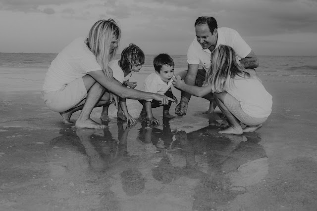 family has professional photo while picking shells