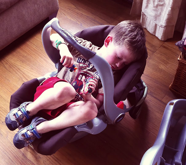 15+ Hilarious Pics That Prove Kids Can Sleep Anywhere - Napping In A Baby's Car Seat