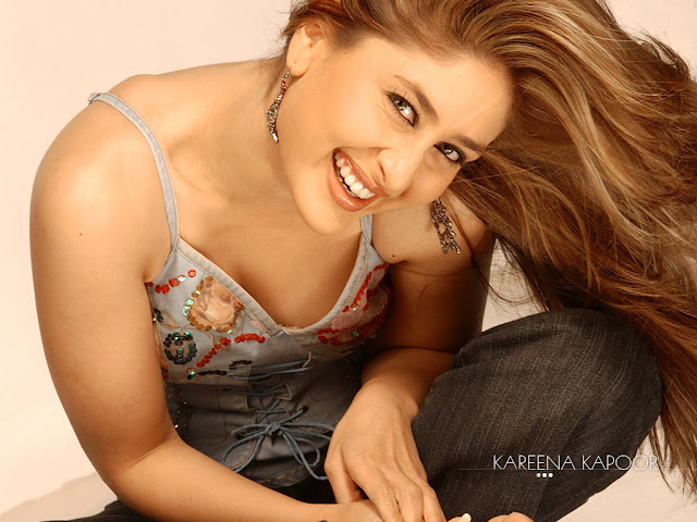 Kareena Kapoor 90s Wallpaper with a beautiful wide smile.