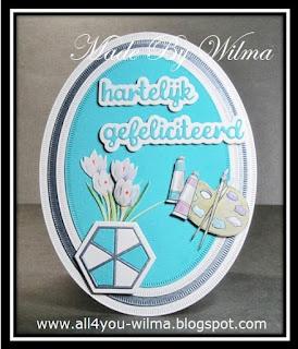 Een ovale felicitatiekaart in de kleuren antraciet-grijs en turquoise met een bloempot met 3d bloemen en een schilderspalet. An oval congratulation card in the colors anthracite-grey and turquoise with a flowerpot with 3d flowers and a painter's palette.