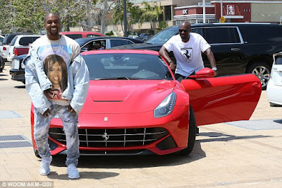 kanye west poses with Corey Gamble's ferrari