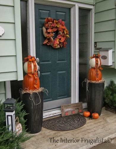 Decorating the front entry with Pumpkin Topiaries.