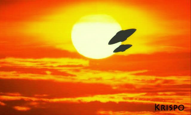 dos ovnis volando ante el sol
