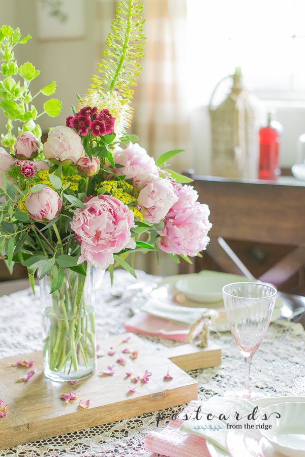 pink peonies and pink depression glassware on spring tablescape