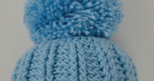 Free Crochet Baby Hat Pattern Ribbed Baby Hat With a large pom pom Perfect for Baby