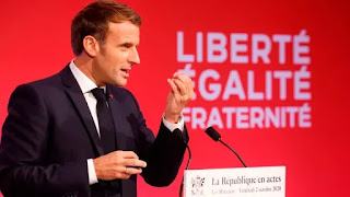 French President Emmanuel Macron delivers a speech to present his strategy to fight separatism on Friday Oct. 2, 2020, in Les Mureaux, outside Paris. Lawmakers in France passed the bill Tuesday in a first hurdle to it becoming law. (Ludovic Marin/Pool via The Associated Press)