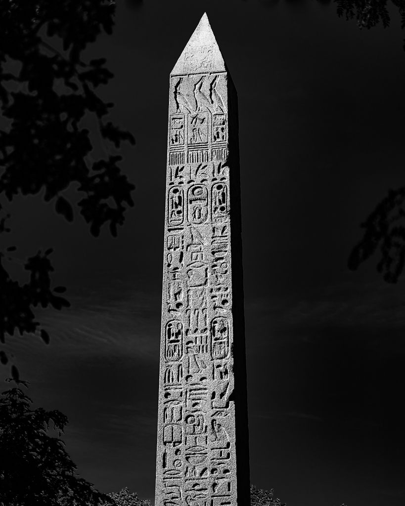 a photo of an Egyptian Obelisk In Central Park new york city