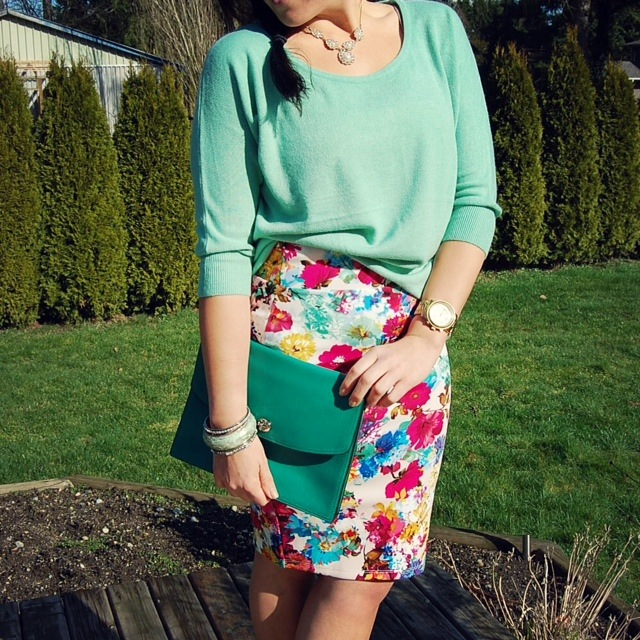Floral scuba skirt, mint Forever 21 sweater and a green Coach Legacy iPad clutch.