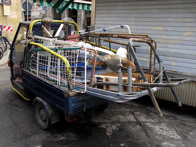 Ape car loaded with scrap iron, Livorno