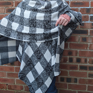 shawl in black and white check worn wrapped around