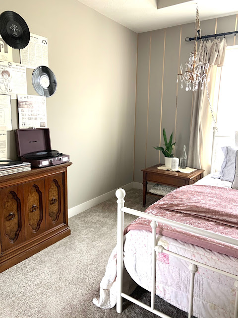 gold washi tape accent wall behind bed