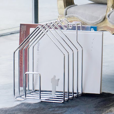white magazine rack shaped like a house