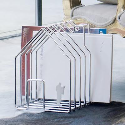 white magazine rack shaped like a house