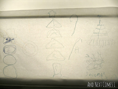 A preschooler's completed tracing of Christmas shapes from And Next Comes L
