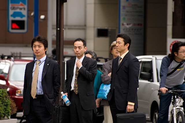 Image Attribute: Japanese salarymen (office workers), wearing the mandatory suit (© 2008 / Chris Gladis, under a Creative Commons license)