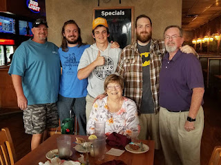 Betty Morton with the men in the family