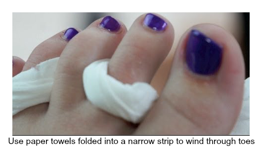 Use paper towels folded into a narrow strip to wind through toes