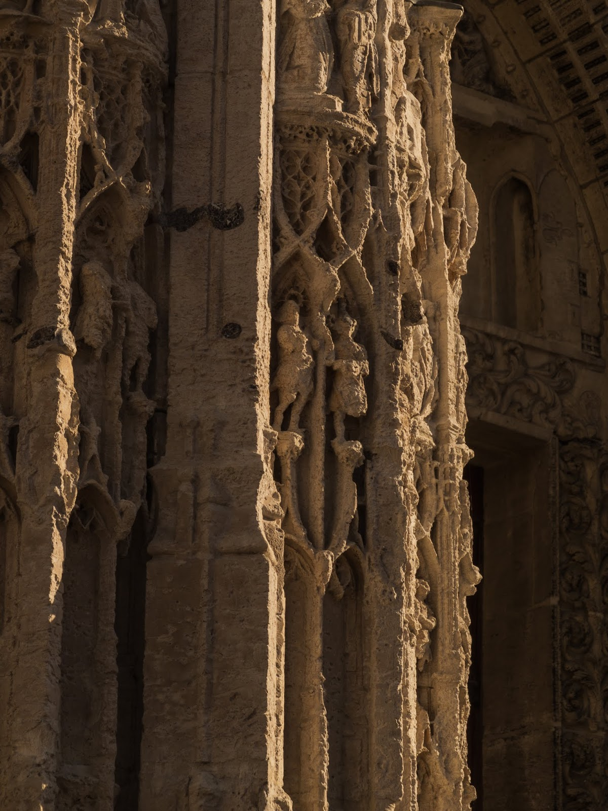 Close up of the wear and tear on the carvings on the facade of Rouen's Cathedral.