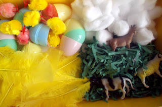 spring sensory tub using all kinds of textures like plastic grass and feathers