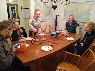 Erik, Sylvia, Dawn, Tom and Jane around table with cake