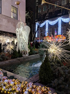 Angels made of white lights with long golden trumpets along the promenade leading to the Christmas tree, Rockefeller Center, New York, New York