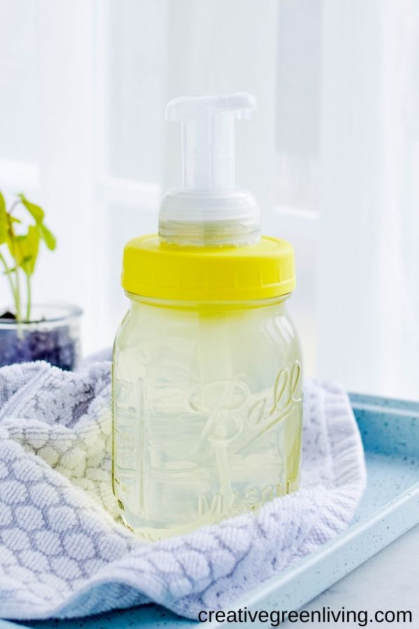 How to upgrade a glass mason jar to be a foaming hand soap dispenser by using this DIY upcycling hack. Learn how to make your own farmhouse style soap dispenser that you can refill over and over again at home. Perfect for handwashing in both the bathroom and kitchen.  #foamingsoap #masonjar #farmhousestyle #masonjarhack #upcycling