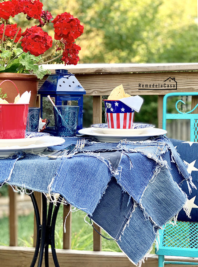 red white and blue tablescape with rustic jean tablescloth