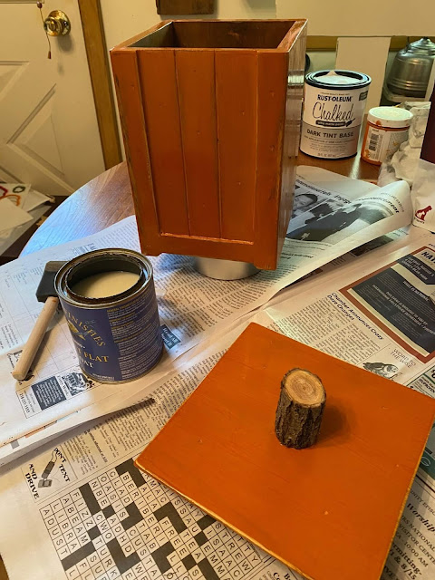 Photo of a wooden canister painted orange