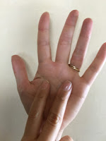 An open palm with two fingers from the other hand signifies seven in Japan
