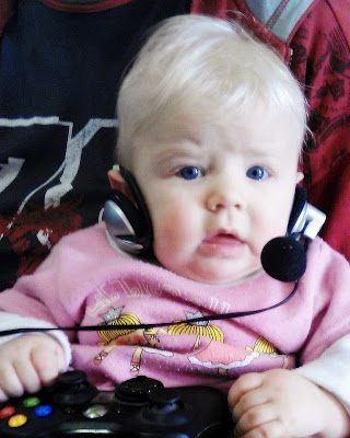 Gamer baby noob wearing headset and holding controller