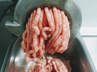 Making Chicken mince in a meat mincer