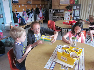 Students observing spiders in classroom.