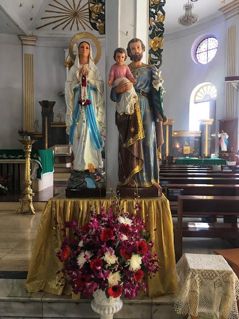 statues of the holy family at catholic church bangkok thailand
