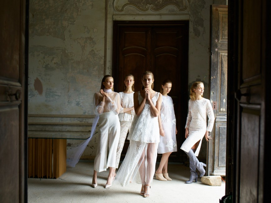 Models wearing white inside room at French Chateau Gudanes for Brahman's Home