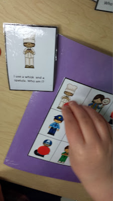 Student playing community helpers game.