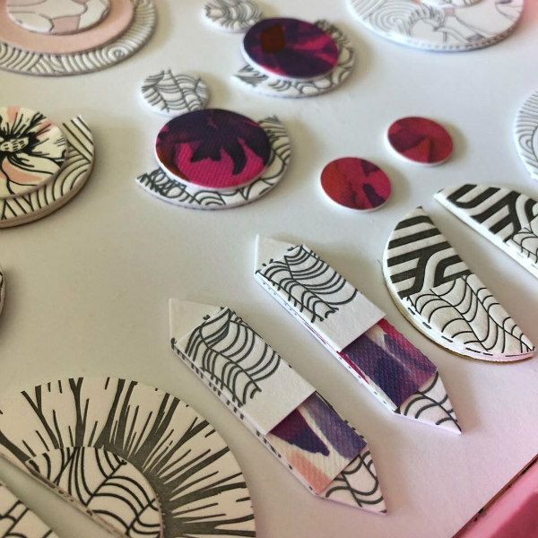 letterpress earring components in shades of red and purple, black and white