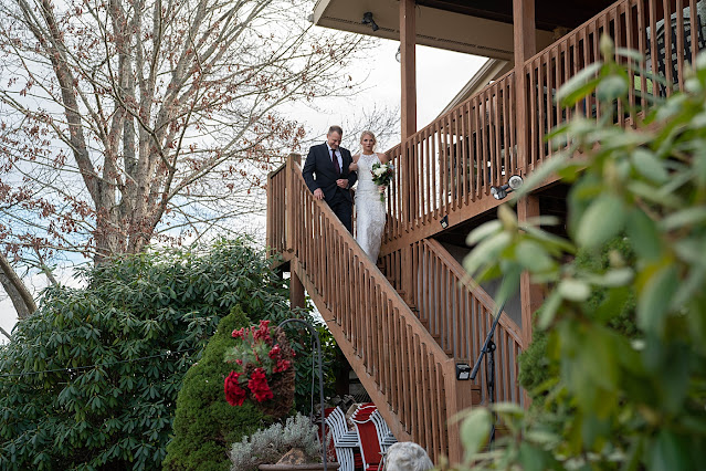 Bride and father walking down wooden staircase Magnolia Farm Asheville Wedding Photography captured by Houghton Photography