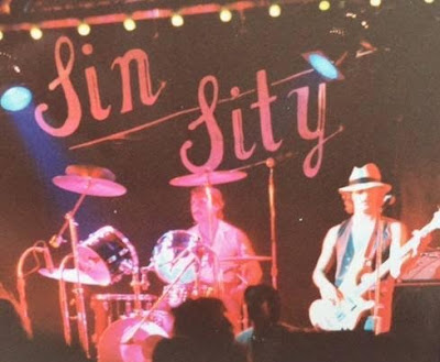 Sin Sity... Mike Edie (Lead vocals/Guitars)  Bob Sartori (Drums)  Jim Sartori (Bass)  Bill Burke (Guitars)  Tim Comella (Guitars)