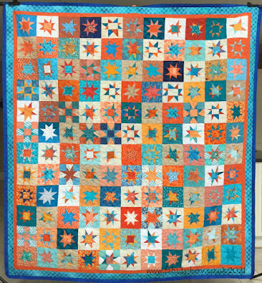 Wacky stars Quilt, made by Wye Knots quilt Group, auctioned by the Welsh Air Ambulance