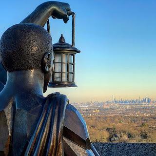 Statue overlooking NYC skyline