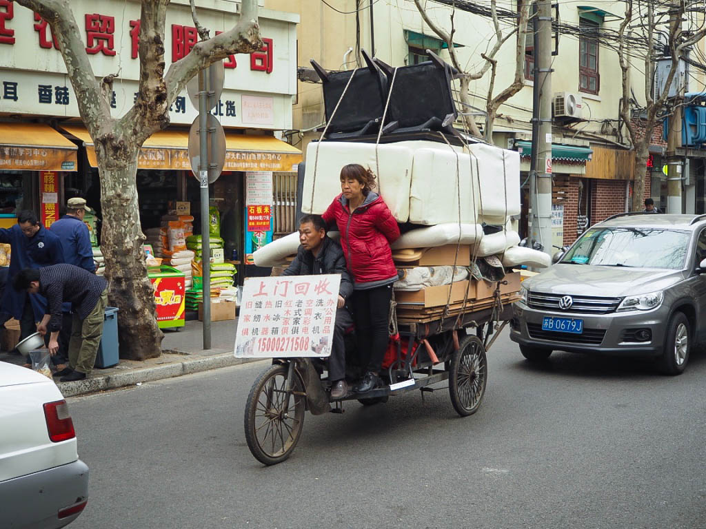 People moving furniture on a bike in Shanghai