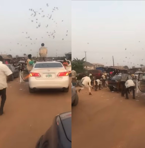 Suspected Yahoo boys were seen throwing money to the air in Benin (Watch video)