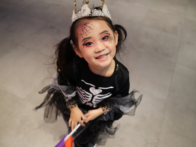 girl dressed up as a skeleton queen posing for a photo