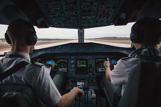 Why do pilots sit on the left seat of the cockpit?