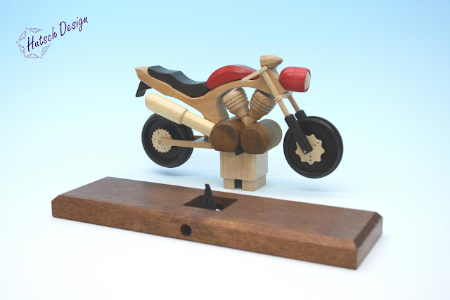 https://www.volkskunst-seiffen.de/R----uchermotorrad-Touring-rot.html