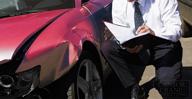 Insurance Agent preparing car accident estimate