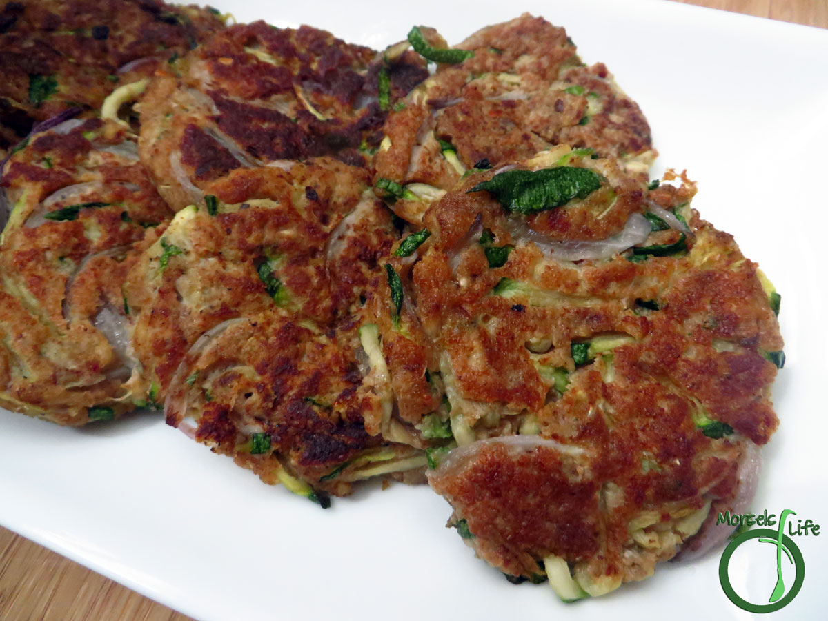 Morsels of Life - Zucchini Cakes - Julienned zucchini, combined with sweet onions and salty Cotija cheese, formed into little cakes with breadcrumbs and egg, then pan-fried into perfect little zucchini cakes.